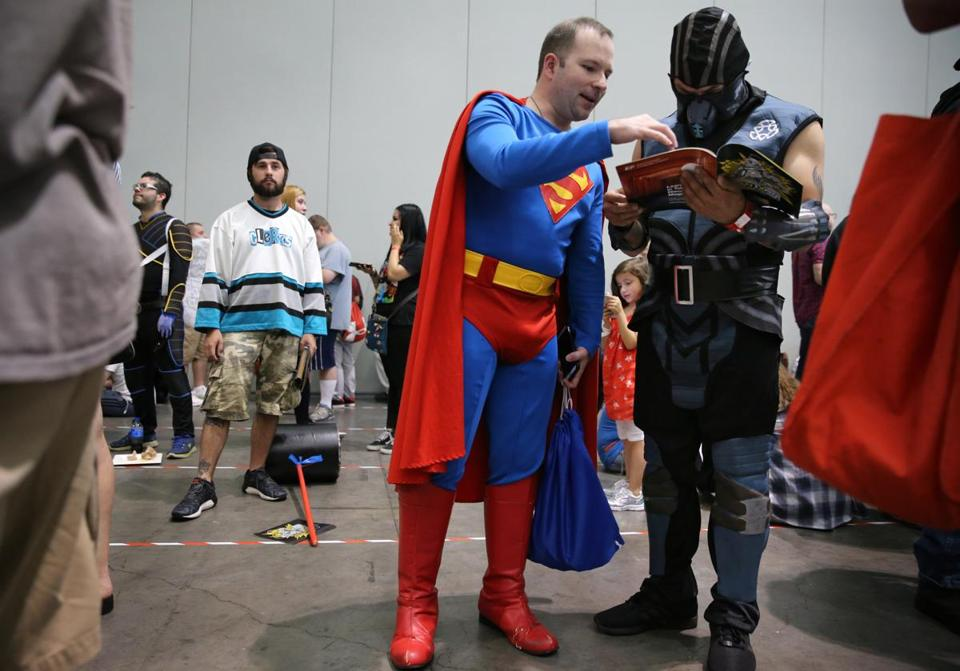 Justin Curry, dressed as Superman, and Dan Kline, dressed as Sub-Zero, waited in line.
