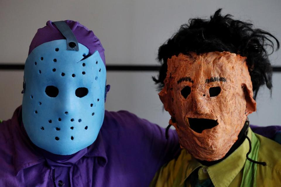 "Identical twin brothers Brian and Conner White, 22, of Billerica dressed as Jason Voorhees (""Friday the 13th"") and Leatherface (""The Texas Chainsaw Massacre"")."