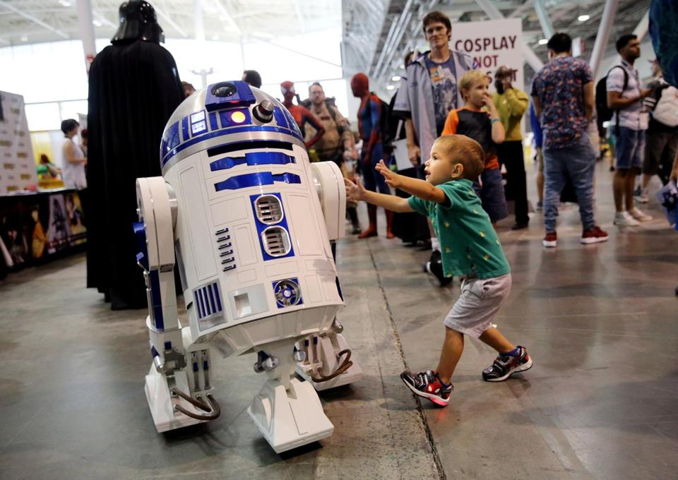 Elias Winslow, 2, of Oxford, greeted R2-D2.