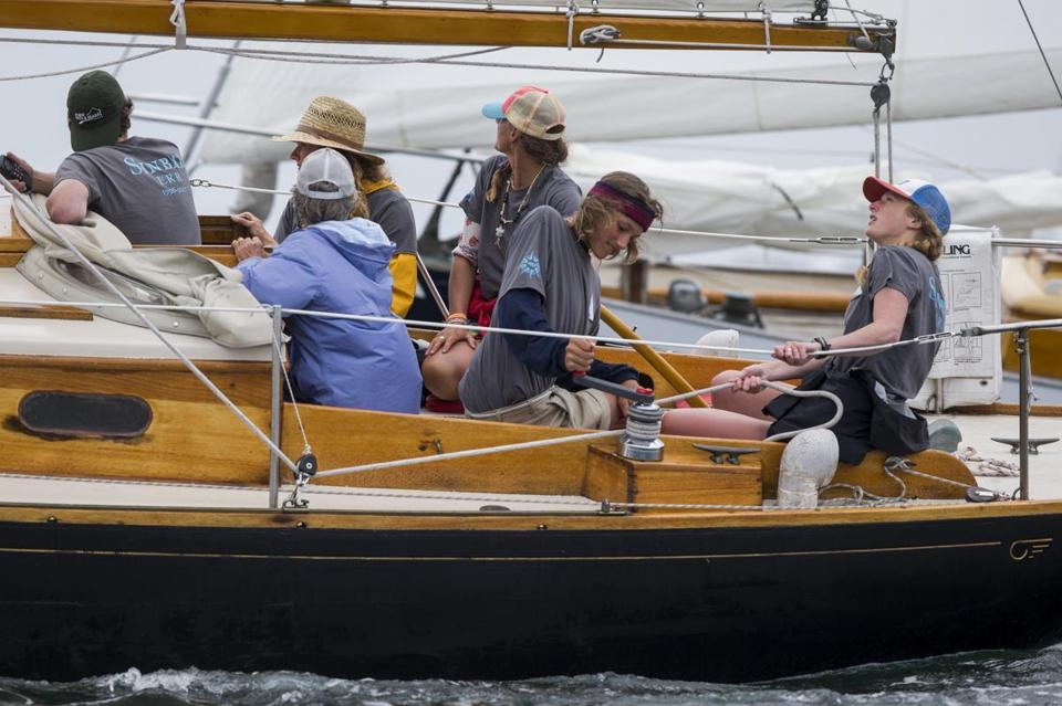 Members of the Conover family sail Sinbad during the Eggemoggin Reach Regatta off Brooklin, Maine.