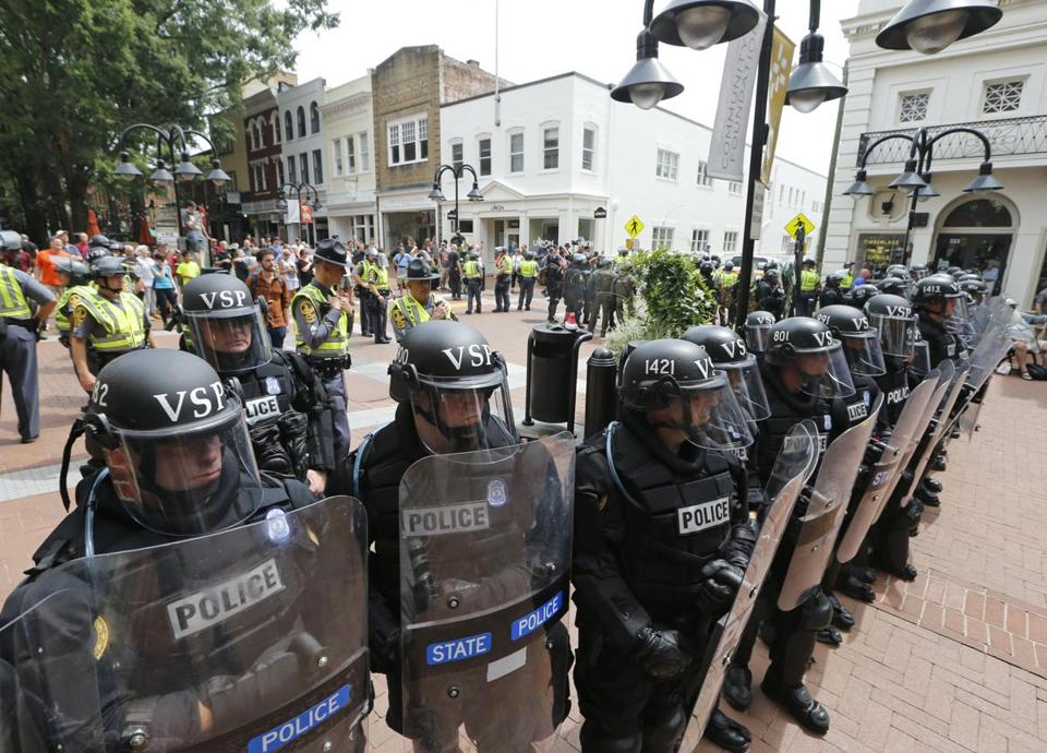 Virginia State Police cordoned off an area around the site where a car ran into a group of protesters after a white nationalist rally in Charlottesville.