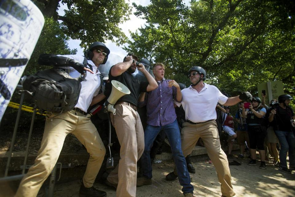 Protesters stood in front of state troopers in attempt to block them in during Saturday's chaos in Charlottesville, Va.