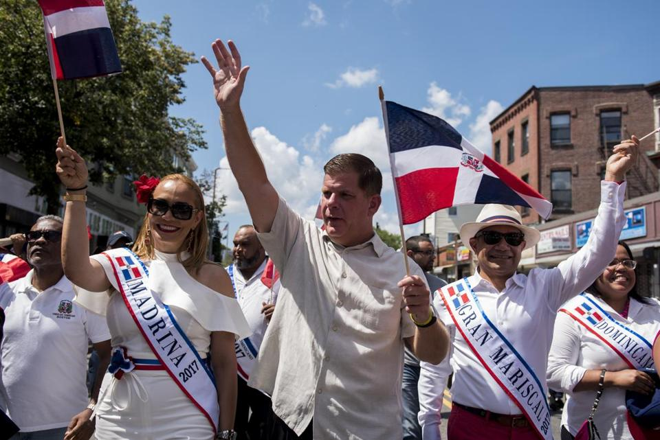 Boston, MA - 8/13/17 - Mayor Martin J. Walsh marches during the Dominican Parade down Centre St on Sunday, August 13, 2017. (Nicholas Pfosi for The Boston Globe) Topic: 14parade(2)