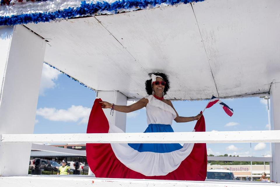 Boston, MA - 8/13/17 - Minerva Reyes poses for pictures from her float during the Dominican Parade down Centre St on Sunday, August 13, 2017. (Nicholas Pfosi for The Boston Globe) Topic: 14parade(2)