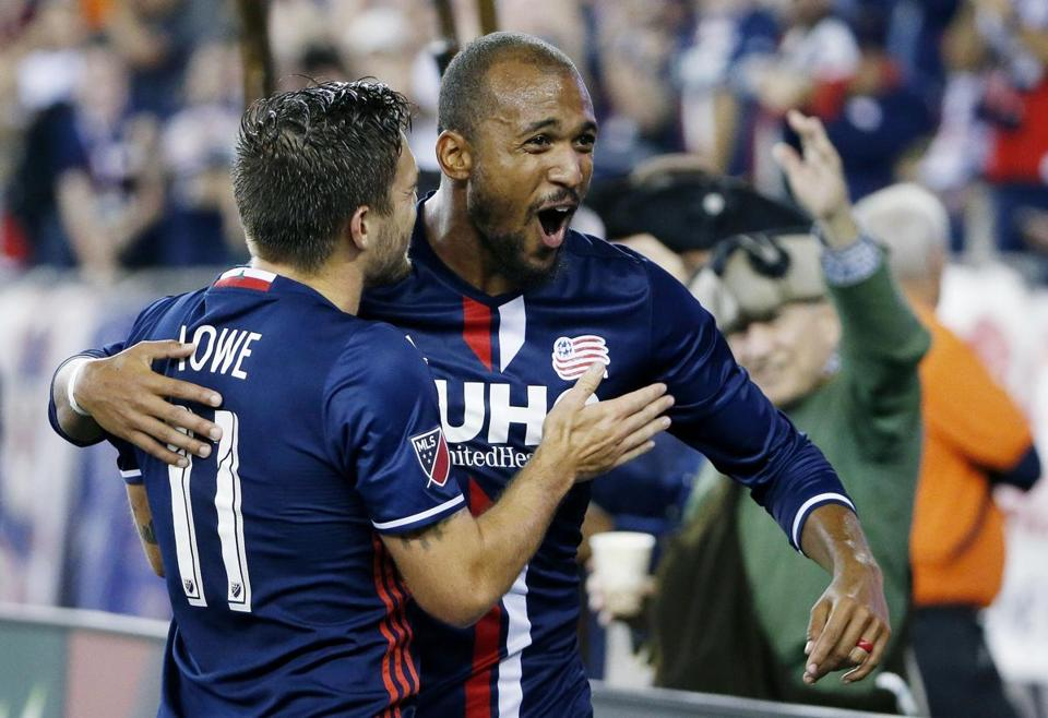 New England Revolution's Teal Bunbury celebrates his goal with teammate Kelyn Rowe (11) during the second half of an MLS soccer game against the Vancouver Whitecaps, Saturday, Aug. 12, 2017, in Foxborough, Mass. (AP Photo/Michael Dwyer)