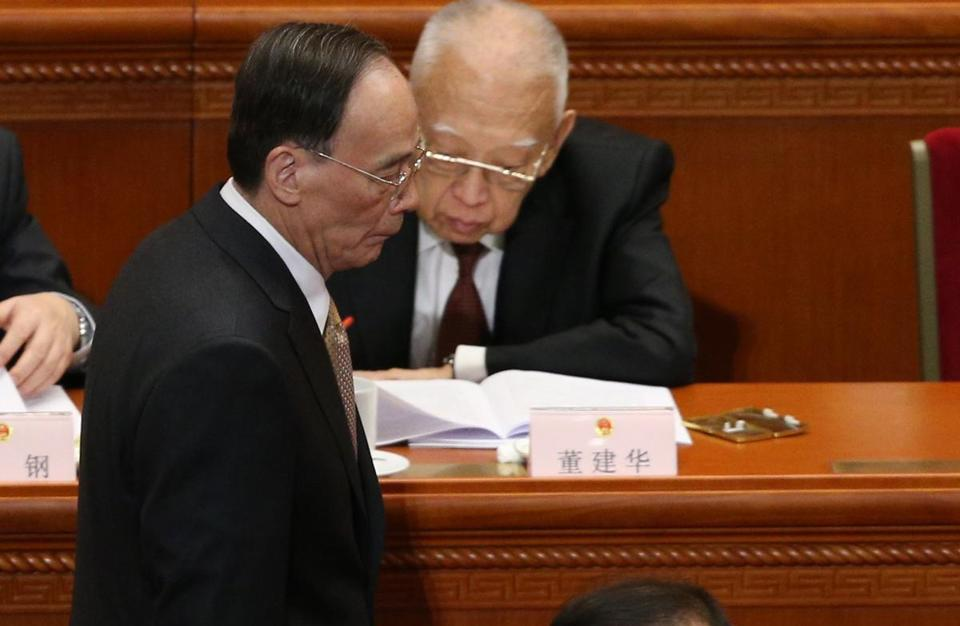 epa06092748 (FILE) - A file photo dated 05 March 2017 of Wang Qishan (L), Secretary of the Central Commission for Discipline Inspection, walking past by Sun Zhengcai (R), Chongqing municipality Communist Party secretary, during the opening of the fifth Session of the 12th National People's Congress (NPC) at the Great Hall of the People in Beijing, China. Sun Zhengcai is under investigation for violating party regulations, according to media reports on 17 July 2017. EPA/WU HONG