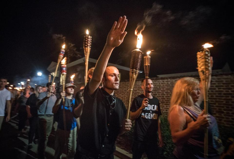 "Chanting ""White lives matter!"" ""You will not replace us!"" and ""Jews will not replace us!"" several hundred white nationalists and white supremacists carrying torches marched in a parade through the University of Virginia campus on Aug. 11. MUST CREDIT: Photo by Evelyn Hockstein for The Washington Post."