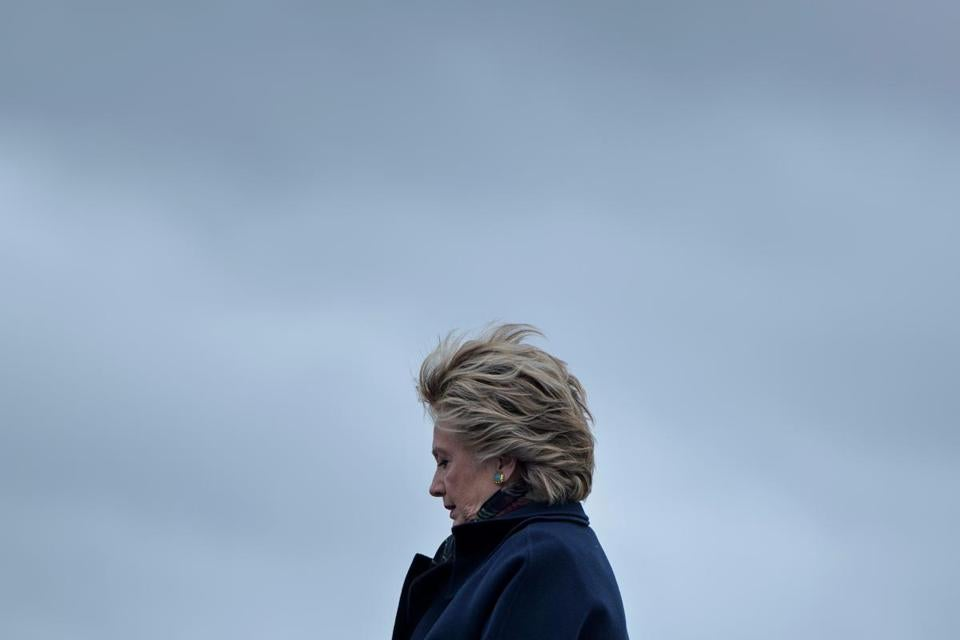 "(FILES) This file photo taken on October 14, 2016 shows former Democratic presidential nominee Hillary Clinton arriving at Boeing Field in Seattle, Washington. Clinton promises to explain ""what happened"" during her last presidential campaign in her new book, set to lauch on September 12, 2017. ""What Happened"" will reveal what her experience was like during one of the most controversial US elections. / AFP PHOTO / Brendan SmialowskiBRENDAN SMIALOWSKI/AFP/Getty Images"