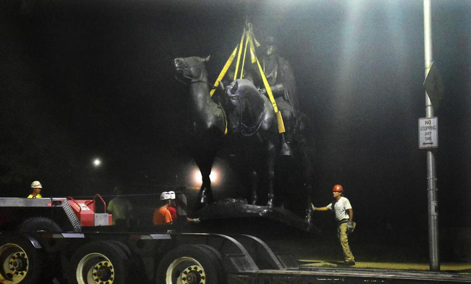 "Baltimore workers removed the Robert E. Lee and Thomas J. ""Stonewall"" Jackson monument in Wyman Park early Wednesday."