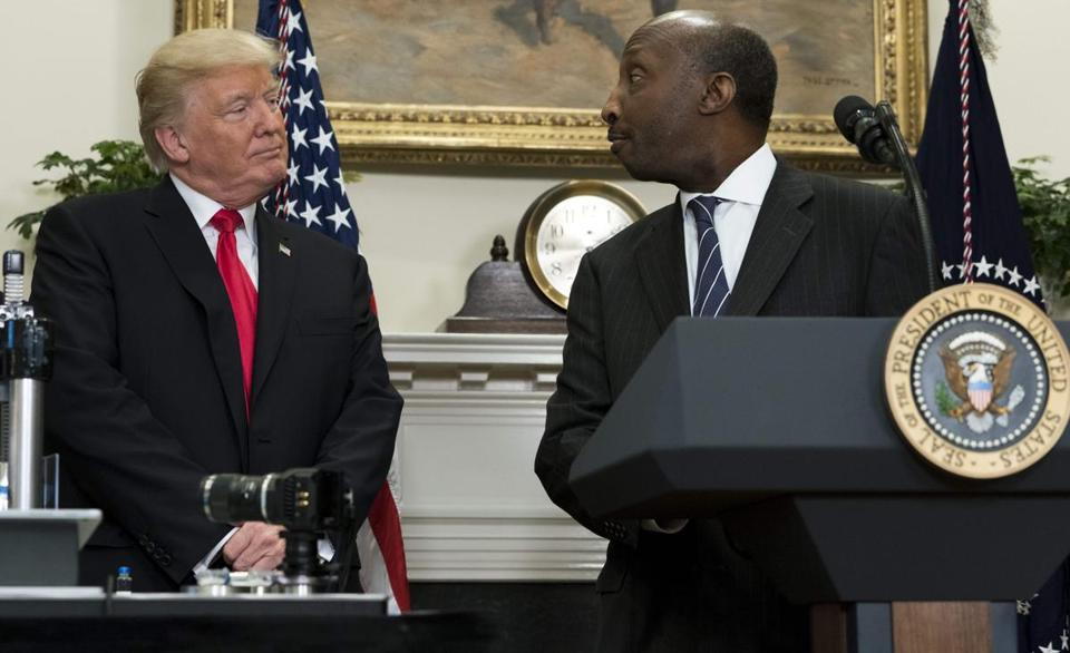 (FILES) This file photo taken on July 20, 2017 shows US President Donald Trump speaking with Ken Frazier (R), CEO of Merck, during a Made in America Week event in the Roosevelt Room of the White House in Washington, DC, July 20, 2017. Trump announced Wednesday he was scrapping two business advisory councils in the wake of several high-profile resignations in protest over his comments on a white supremacist rally in Virginia that turned violent. The CEOs of Merck, Intel and Under Armour were among those who quit the forums following Trump's comments about Saturday's violence in Charlottesville, Virginia. / AFP PHOTO / SAUL LOEBSAUL LOEB/AFP/Getty Images