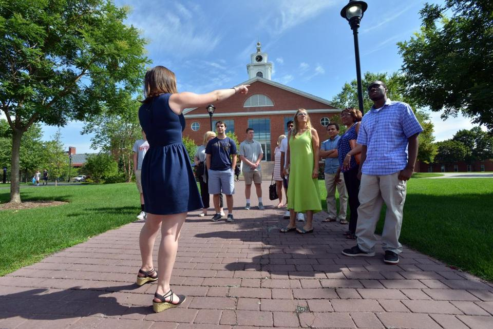 Junior Jackie Emmons of Boxford (left) led prospective students, including Cedane Richards of Hartford (right), on a tour at Bentley University.