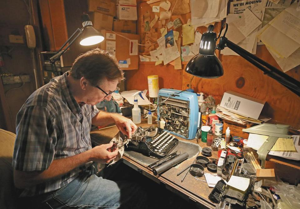 Tom Furrier, the last typewriter repairman in the area, works on a vintage Corona in his Arlington shop. Many of his old machines, such as the Royals and Remington Rand below, are used for parts.