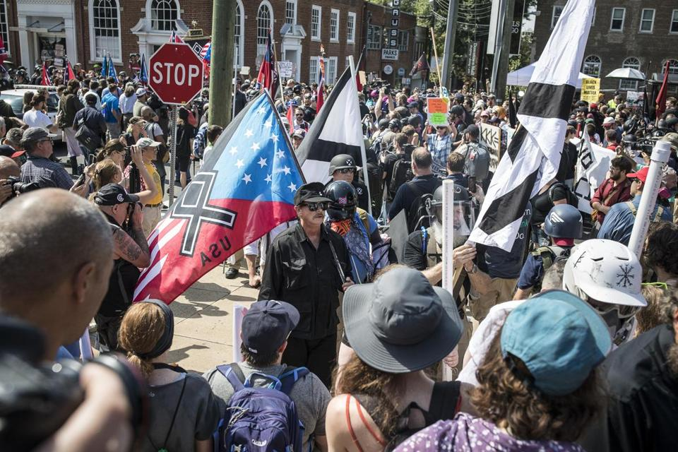 "FILE-- White nationalists and counter protesters rally on Saturday in Charlottesville, Va., Aug. 12, 2017. Prime Minister Benjamin Netanyahu of Israel has remained uncharacteristically tongue-tied about President Donald Trump's defiant attempts to apportion equal blame to the ""alt-left"" for the violence in Charlottesville, Va., and the neo-Nazis and white supremacists who instigated the protests. (Edu Bayer/The New York Times)"
