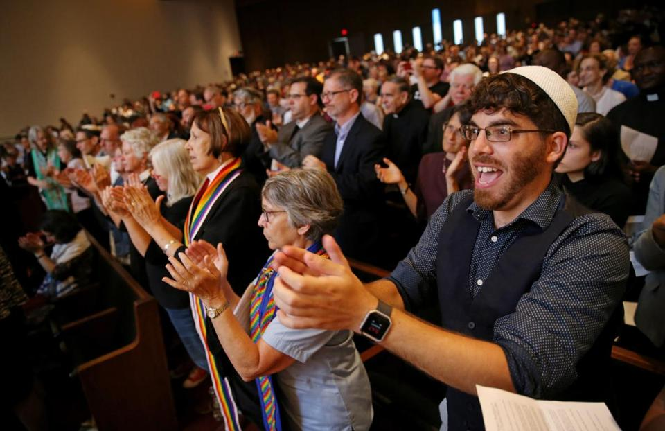 Boston, MA- August 18, 2017: Bryan Mann, a rabbinical school student, applauds comments from Attorney General Maura Healey during the Interfaith Gathering of Unity, Love, and Strength at Temple Israel of Boston in Boston, MA on August 18, 2017. Organized by the Greater Boston Interfaith Organization, the gathering offered an opportunity to come together and send a message of unity and diversity in the face of hate. Thousands of protesters are expected to flood downtown Boston Saturday, with a pro-free speech rally on Boston Common likely surrounded by several different counter-actions. (CRAIG F. WALKER/GLOBE STAFF) section: metro reporter: