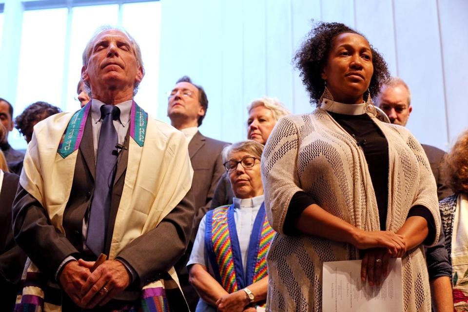Boston, MA- August 18, 2017: Cantor Roy Einhorn, left, of Temple Israel and Rev. Mariama White-Hammond of Bethel AME listen to the Call to Prayer during the Interfaith Gathering of Unity, Love, and Strength at Temple Israel of Boston in Boston, MA on August 18, 2017. Organized by the Greater Boston Interfaith Organization, the gathering offered an opportunity to come together and send a message of unity and diversity in the face of hate. Thousands of protesters are expected to flood downtown Boston Saturday, with a pro-free speech rally on Boston Common likely surrounded by several different counter-actions. (CRAIG F. WALKER/GLOBE STAFF) section: metro reporter: