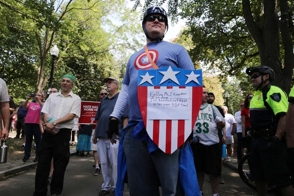 "A man dressed as Captain America protested the ""free speech"" rally."