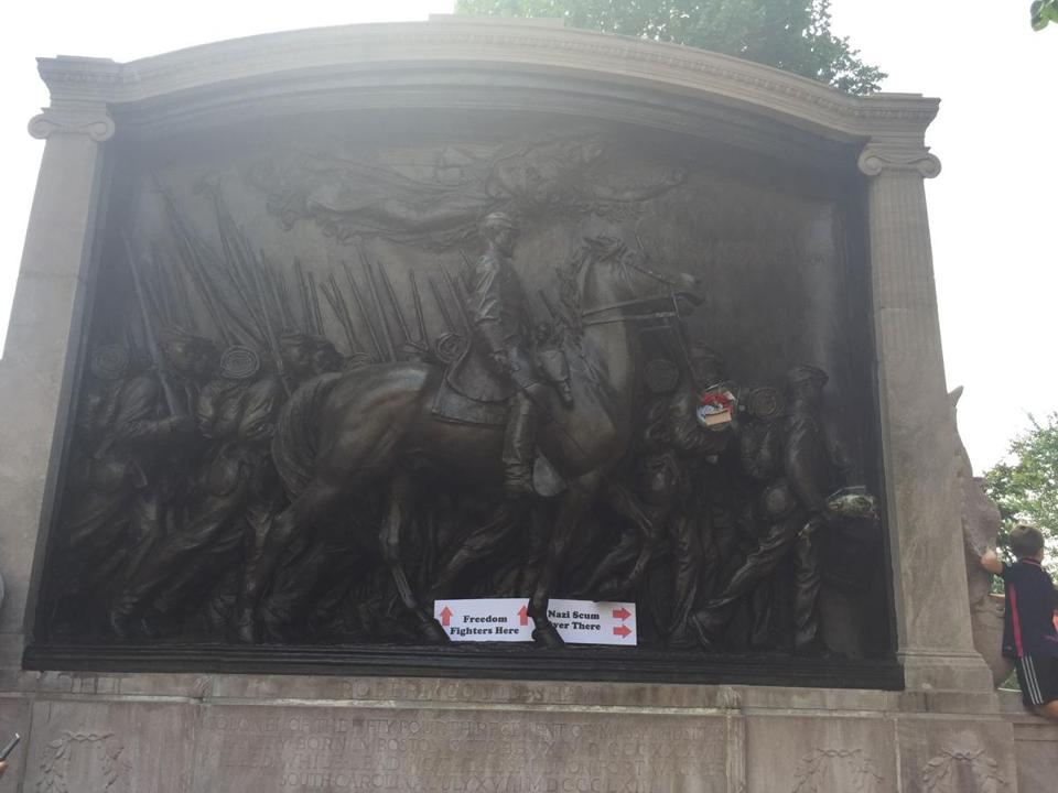 A sign on the Robert Gould Shaw Memorial near Boston Common.