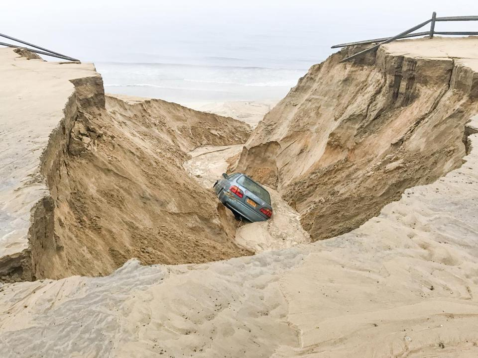 In Wellfleet, which received between 6 and 7 inches of rain, the weather caused a car to fall into a sinkhole as the beach eroded away.