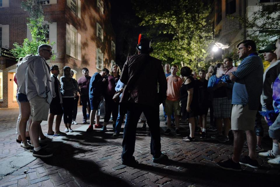 Dr. Michael Vitka, who identifies himself as a historian and paranormal investigator, leads a tour of what he said were haunted locations in Salem. Josh Reynolds for The Boston Globe (Metro, edmondson )