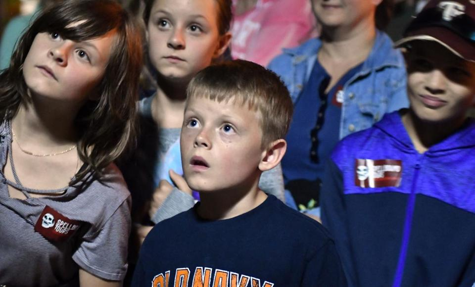 Devin Pilbeam, 8, of Ridgetown, Ontario, listens to a ghost story while on a tour lead by Dr. Michael Vitka, who identifies himself as a historian and paranormal investigator, leads a tour of what he said were haunted locations in Salem. Josh Reynolds for The Boston Globe (Metro, edmondson )