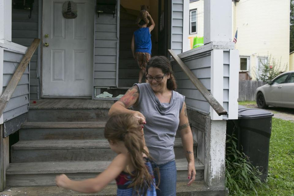 Kate Lauzon, 40, with two of her children. She receives disability payments and works several part-time jobs.