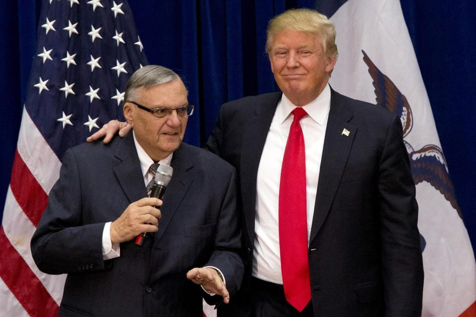 Joe Arpaio (left), then the sheriff of metro Phoenix, with Donald Trump in January 2016 at a rally in Marshalltown, Iowa.