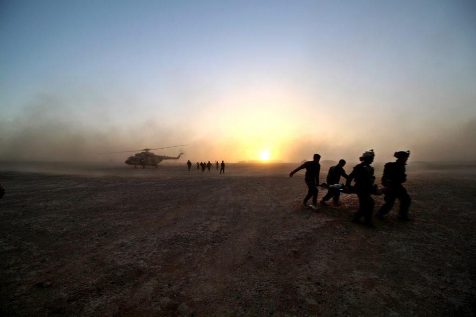 Afghan commandos with the Seventh Special Operations Kandak practiced moving wounded soldiers to an Afghan air force helicopter at Camp Bastion, in Helmand province.