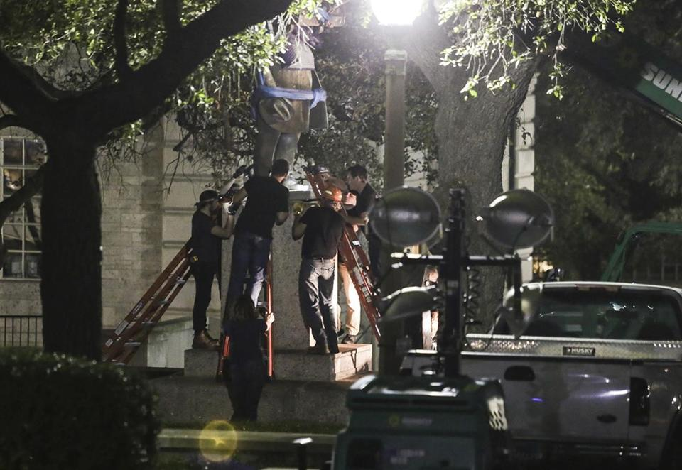 Confederate statutes are removed from the University of Texas early Monday.