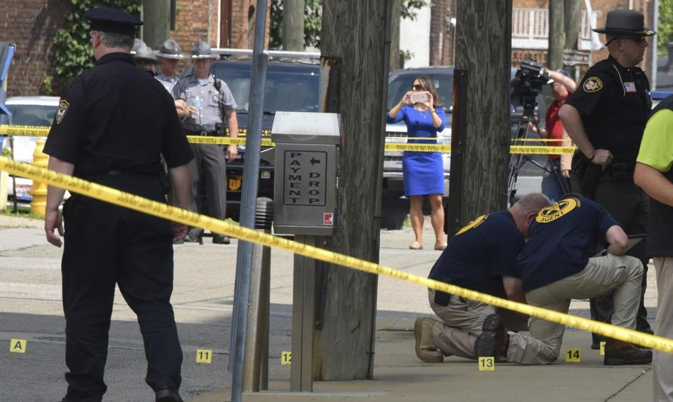 Evidence markers were placed on the street and the sidewalk near the Jefferson County Courthouse in Steubenville, Ohio.