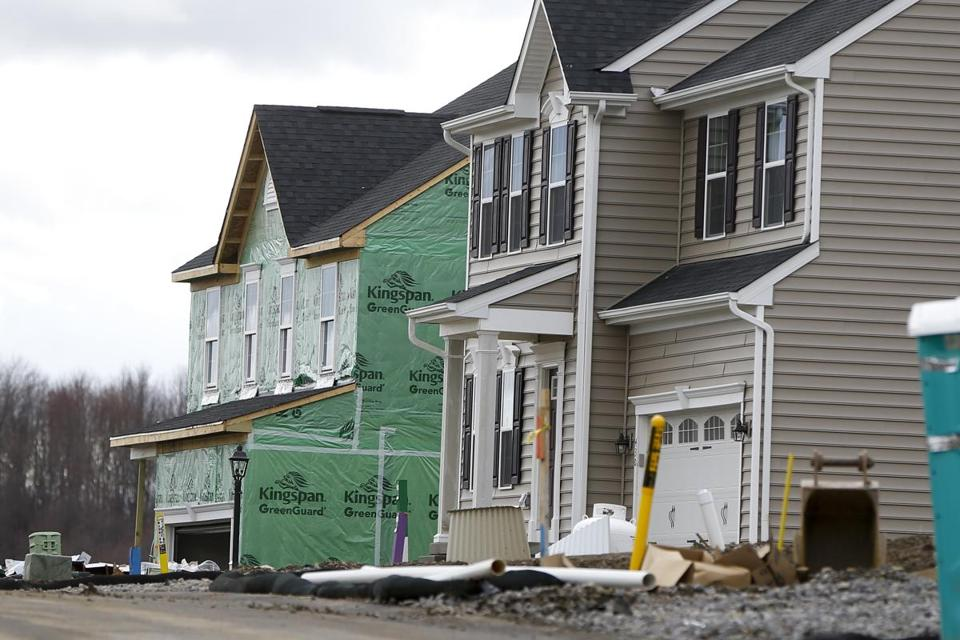 Officials in 14 cities and towns unveiled a new agreement to boost housing development in a bid to blunt rising rents and home prices.