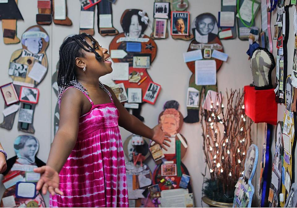 Mansfield-8/23/17 The National Black Doll Museum is in Mansfield with over 6,000 dolls of color. Chaundra Butler, 11 from Mansfield looks at cutous of famous people of color. John Tlumacki/Globe Staff(south)