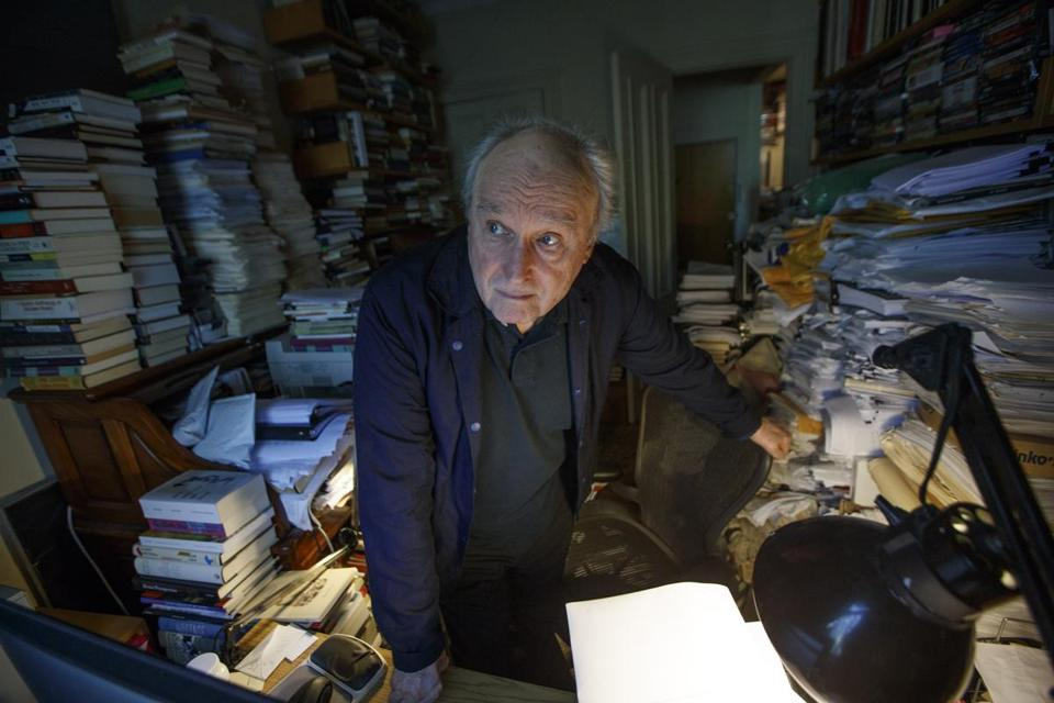 Poet Frank Bidart posed for a portrait in his Cambridge home in August.