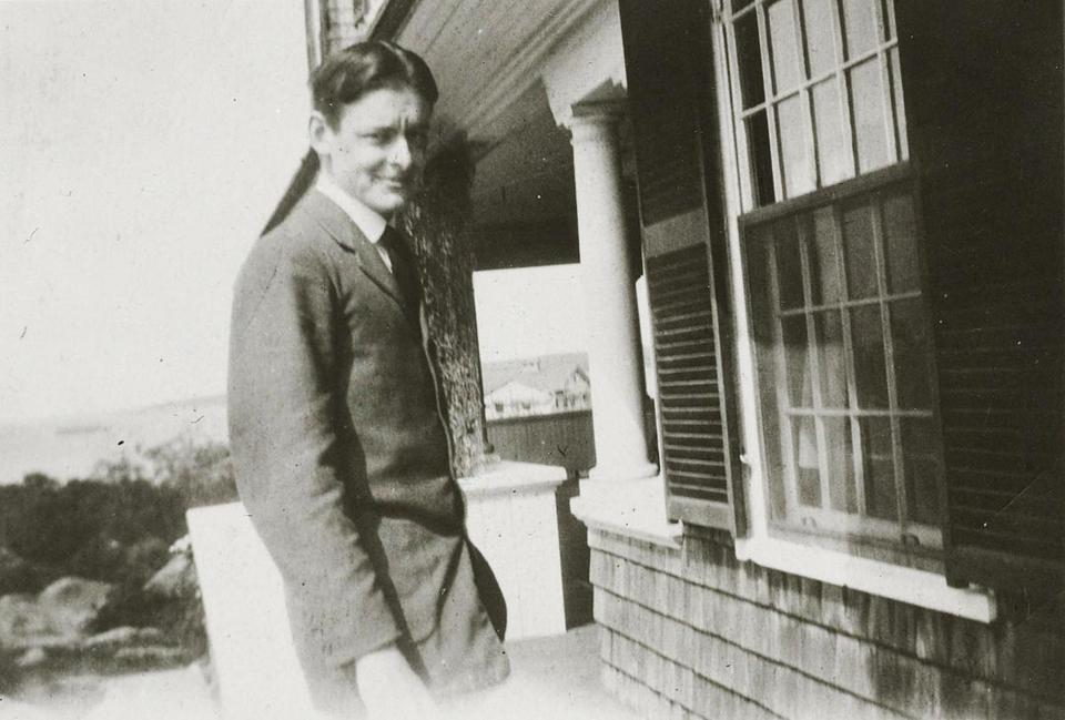 T. S. Eliot on the porch of the wood-shingled home on Eastern Point his father built.