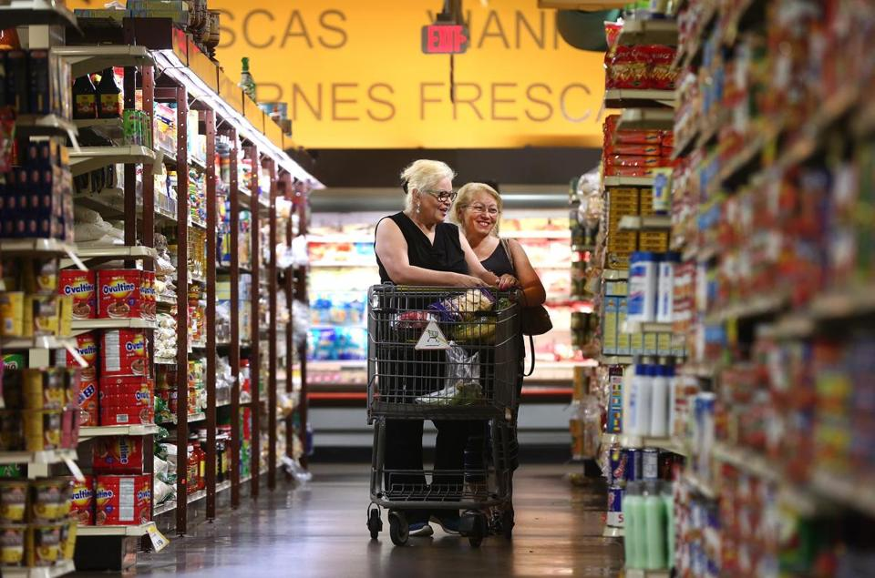 Boston, MA - 8/22/2017 - Sisters Cruz Sanchez (cq), left, of Mattapan, and Frances Rosado (cq), of Dorchester, shop. Tropical Foods, in Roxbury, caters to an international community. Customers are asked about a possible food delivery service in the area. Photo by Pat Greenhouse/Globe Staff Topic: tropicalfoods Reporter: Lauren Feiner