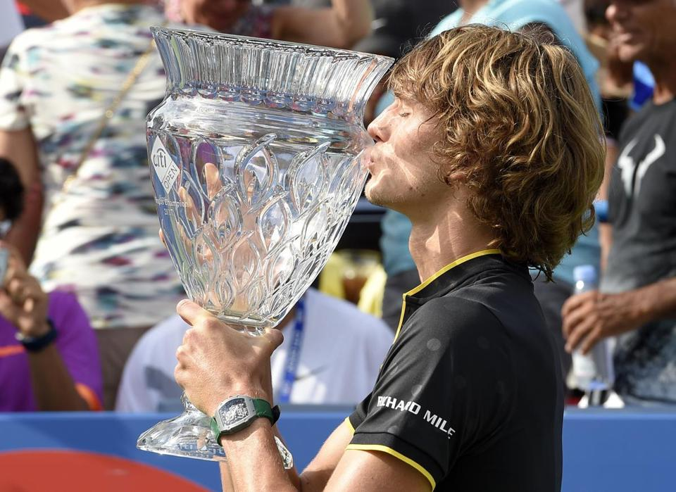 "FILE - In this Aug. 6, 2017, file photo, Alexander Zverev kisses the trophy after he defeated Kevin Anderson to win the Citi Open tennis tournament in Washington. Zverev, a 20-year-old German considered the ""Next Big Thing,"" will play under the lights in Arthur Ashe Stadium on Monday, Aug. 28, 2017, at the U.S. Open. (AP Photo/Nick Wass, File)"