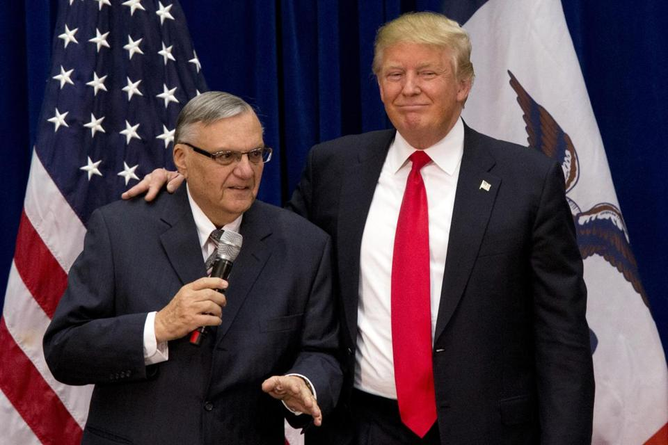 Donald Trump was joined by Maricopa County, Ariz.., Sheriff Joe Arpaio at a new conference in Marshalltown, Iowa, during last year presidential campaign. President Donald Trump has pardoned Arpaio following the former sheriff's conviction for intentionally disobeying a judge's order in an immigration case.