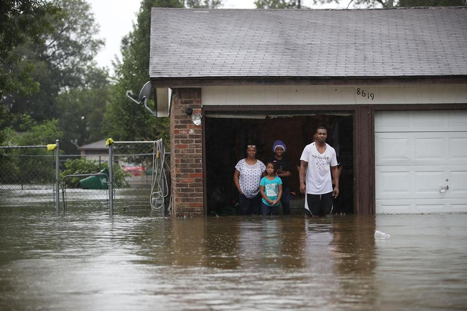 People in Houston Monday waited to be rescued from their flooded homes,