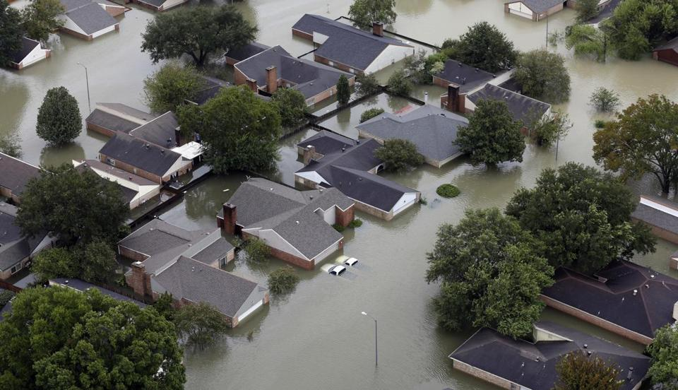 Homes are flooded near the Addicks Reservoir as floodwaters from Tropical Storm Harvey rise Tuesday, Aug. 29, 2017, in Houston. (AP Photo/David J. Phillip)