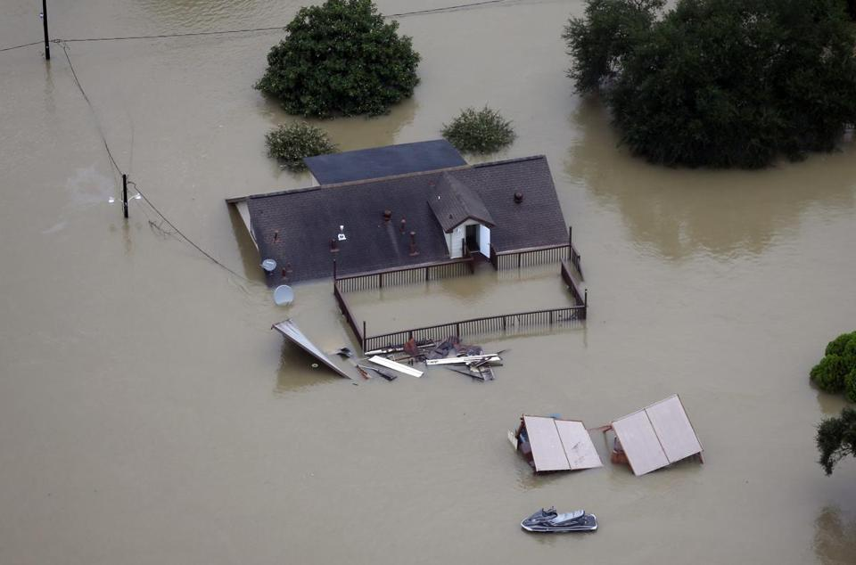 A home in Houston is surrounded by floodwaters.