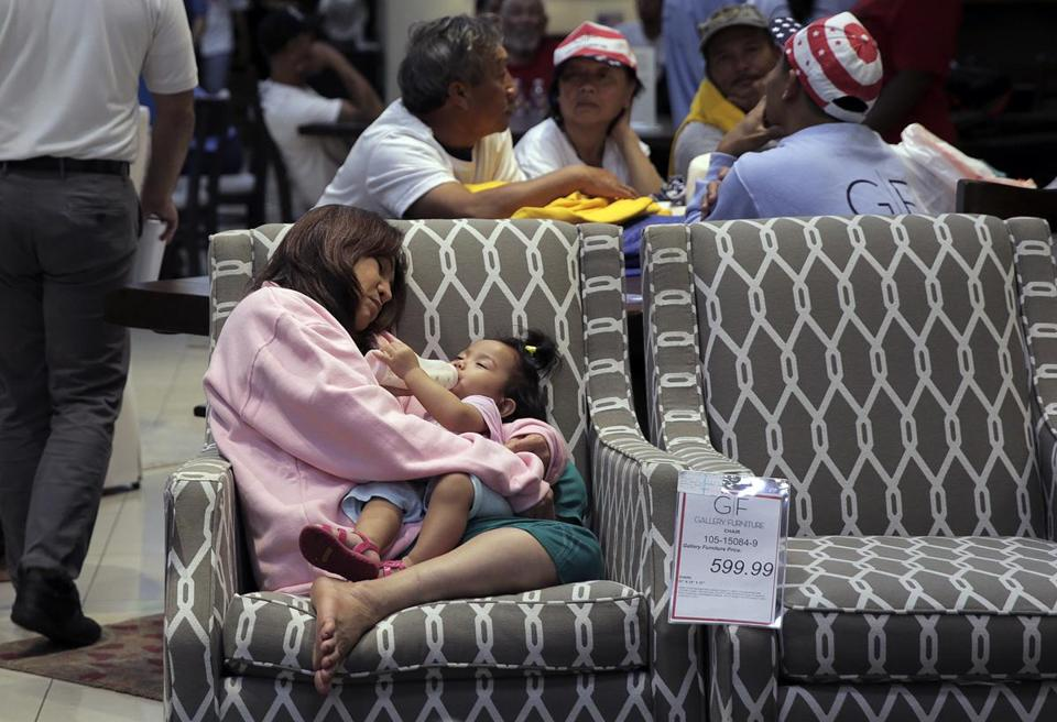 Tomng Vu Held Her One Year Old Granddaughter, Fatima, As They Rested