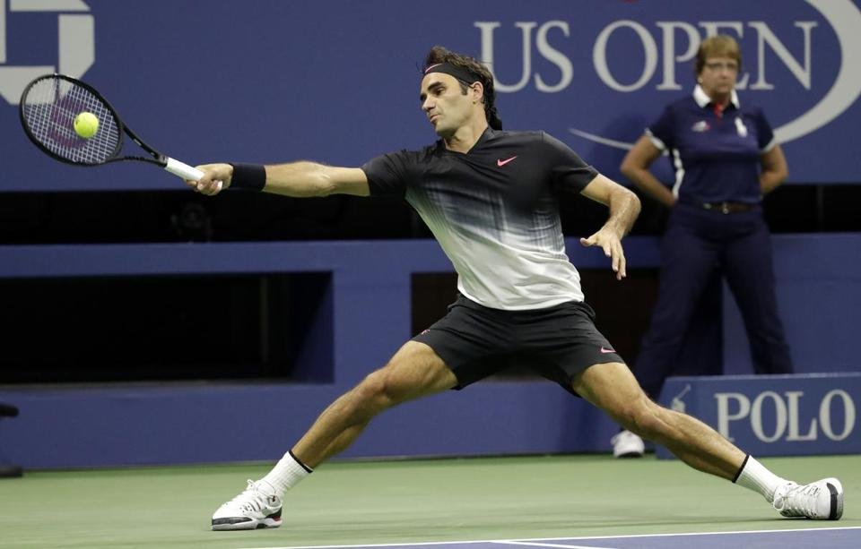 Roger Federer, of Switzerland, stretches to return a shot to Frances Tiafoe, of the United States, during the U.S. Open tennis tournament, Tuesday, Aug. 29, 2017, in New York. (AP Photo/Julio Cortez)