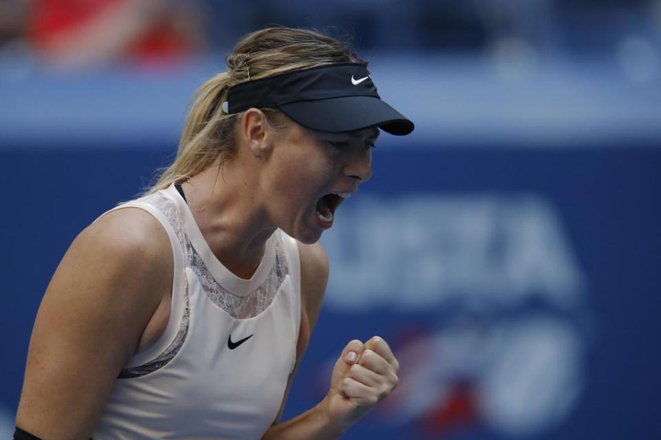 Russia's Maria Sharapova reacts after winning a point against Hungary's Timea Babos during their 2017 US Open Women's Singles match at the USTA Billie Jean King National Tennis Center in New York on August 30, 2017. / AFP PHOTO / EDUARDO MUNOZ ALVAREZEDUARDO MUNOZ ALVAREZ/AFP/Getty Images