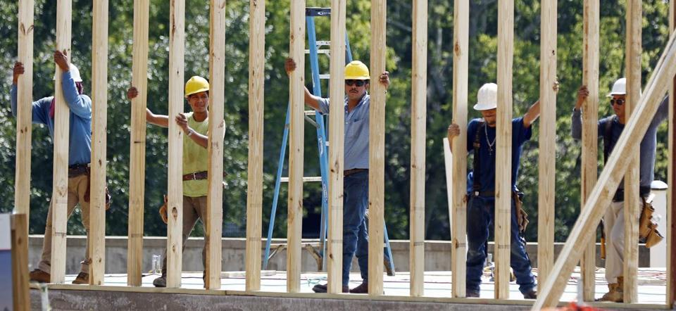 n this Aug. 21, 2017, photograph, construction workers set up a frame for what will eventually become a jewelry store, in Jackson, Miss. On Wednesday, Aug. 30, 2017, payroll processor ADP reports how many jobs private employers added in August. (AP Photo/Rogelio V. Solis)