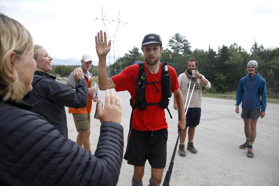 McConaughy slapped hands with a group of hikers who had been waiting to see him cross the bridge after hearing of his attempt at breaking the record.