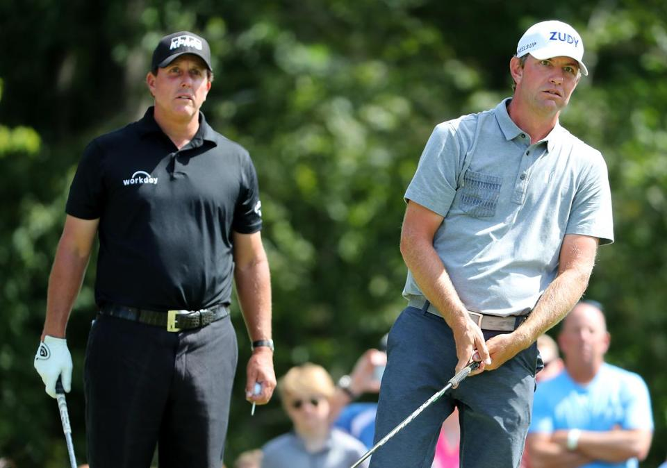 Lucas Glover (right) and Phil Mickelson watching the flight of Glover's tee shot on No. 17.