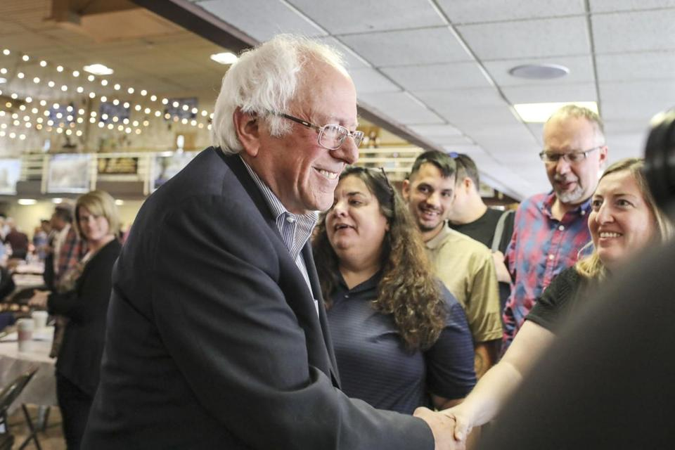 "US Senator Bernie Sanders greeted supporters Monday after speaking in Manchester, N.H. Sanders criticized President Trump for ""trying to divide our nation"" on Monday."