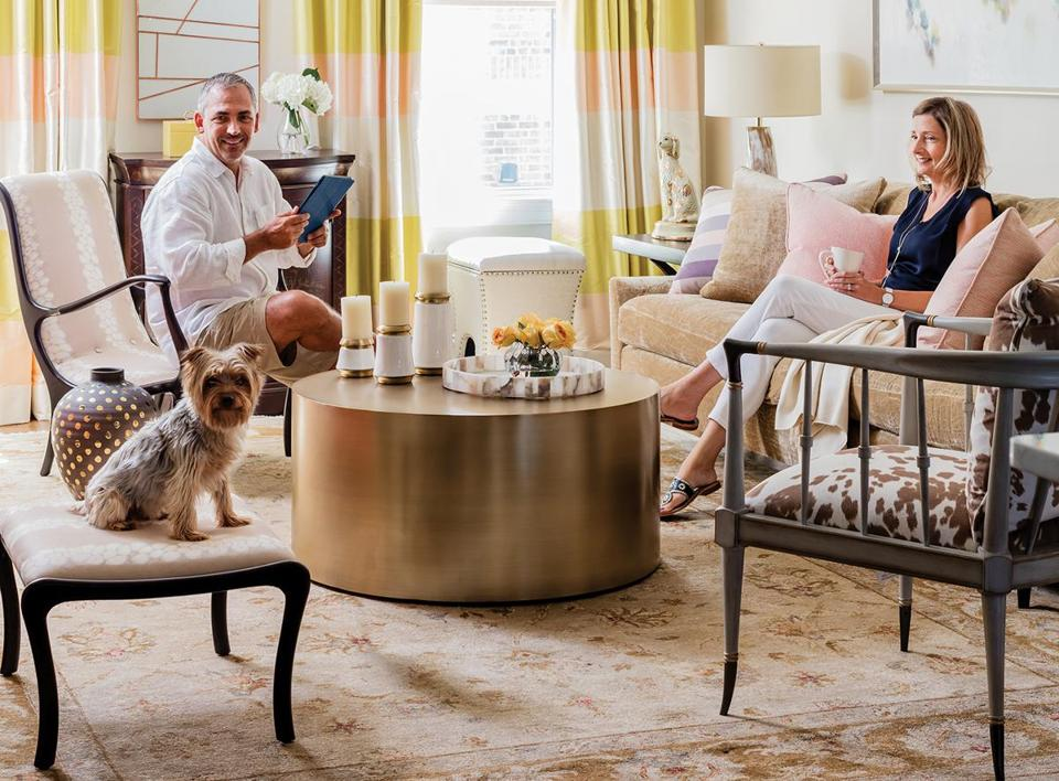 "mpty nesters Dan and Barbara Graovac realized their old furnishings wouldn't work in their new living room. ""Since there was only one really lounge-y place in the whole house, the living room had to be comfortable,"" says designer Ana Donohue. The Verellen sofa is upholstered in a plush Osborne & Little fabric. Mixing materials helped create dimension. ""The oversize gold cocktail table contributes to the really layered design,"" says Donohue. The animal-hide chair is from Cabot House."