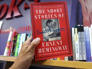 Somerville/Cambridge-09/01/17- Porter Square Bookstore puts some books on a shelf behind the service desk because books by some important authors are being swiped, including Ernest Hemingway. John Tlumacki/Globe Staff(metro)