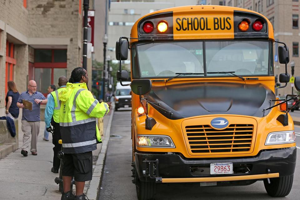 BOSTON, MA - 9/07/2017: Busses arrive in the morning at the Quincy School, Chinatown on the first day of school for Boston that is today with the focus on whether the new bus routes actually work. (David L Ryan/Globe Staff ) SECTION: METRO TOPIC