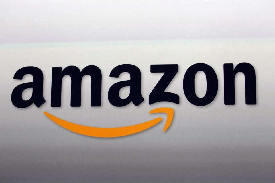 "FILE - This Sept. 6, 2012, file photo, shows the Amazon logo in Santa Monica, Calif. Amazon's ""Prime Day"" is back. Some small and mid-sized food companies are wondering how Amazon's planned purchase of Whole Foods might affect them. The unknowns include whether Amazon might change the grocery chain's food offerings, which now include thousands of products from small and mid-sized businesses. A key question for many companies is whether Whole Foods would place less of an emphasis on buying locally produced and innovative foods in the future. (AP Photo/Reed Saxon, File)"
